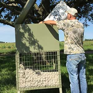 Our cottonseed feeder is easy to fill with a locking lid.